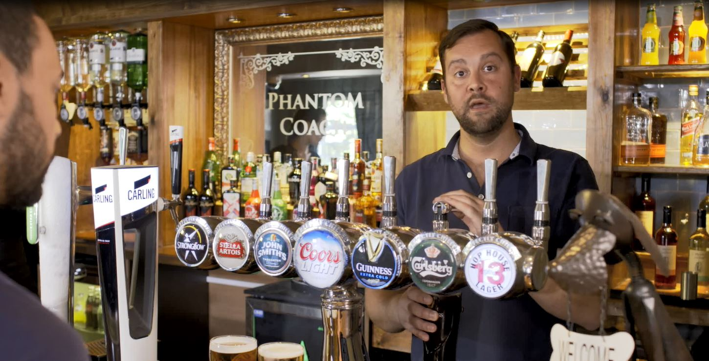 Shot from video about the charity, man behind the bar at pub