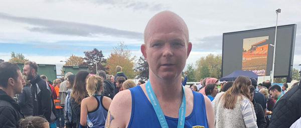 Man with medal after completing marathon